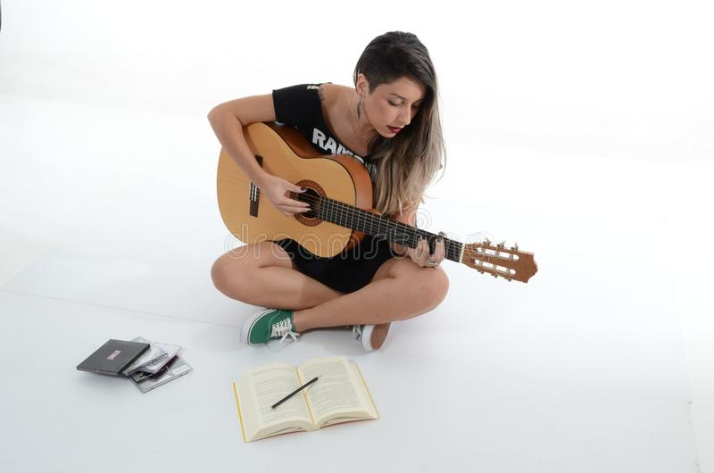 Woman Playing Brown Classical Guitar stock photo