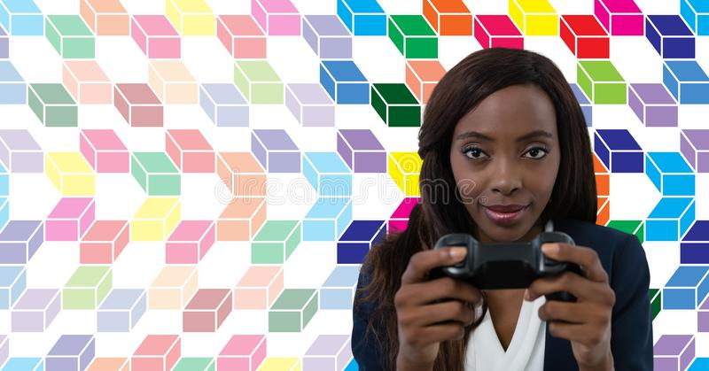 Woman playing computer game with colorful geometric pattern stock photos