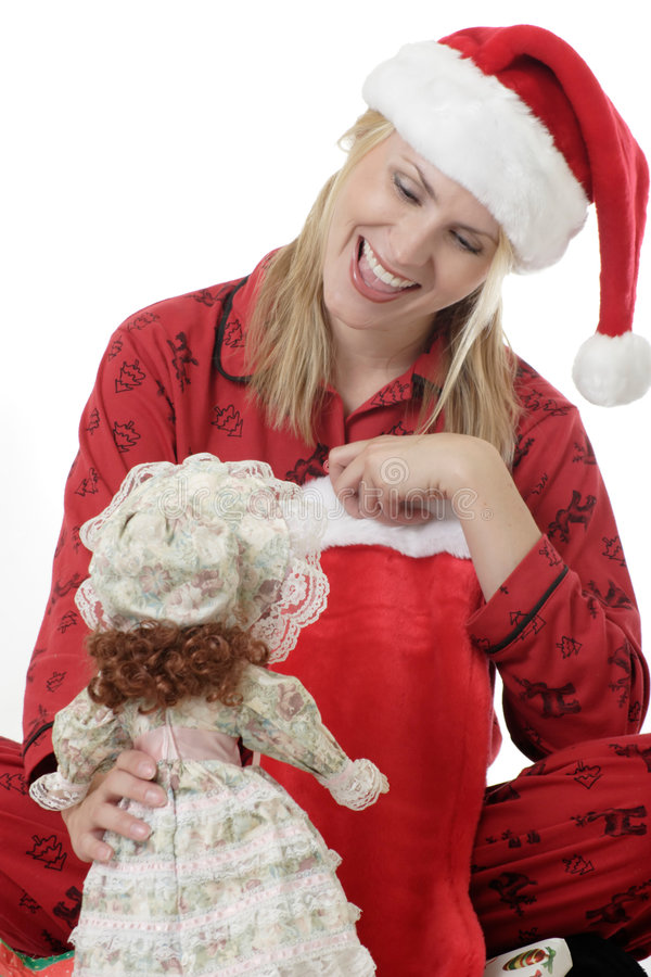Woman playing with a doll on Christmas royalty free stock image