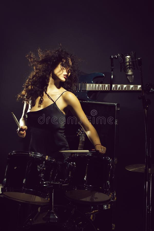 Woman playing drums royalty free stock photography