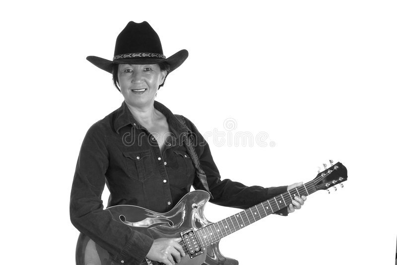 Woman playing electric guitar stock photography