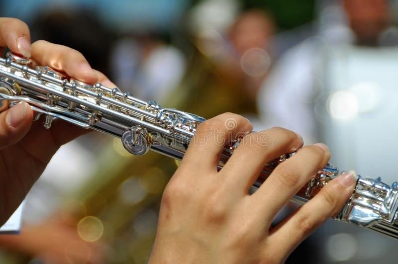 Woman playing flute royalty free stock photo
