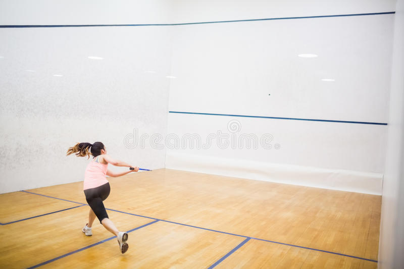 Woman playing a game of squash stock photos