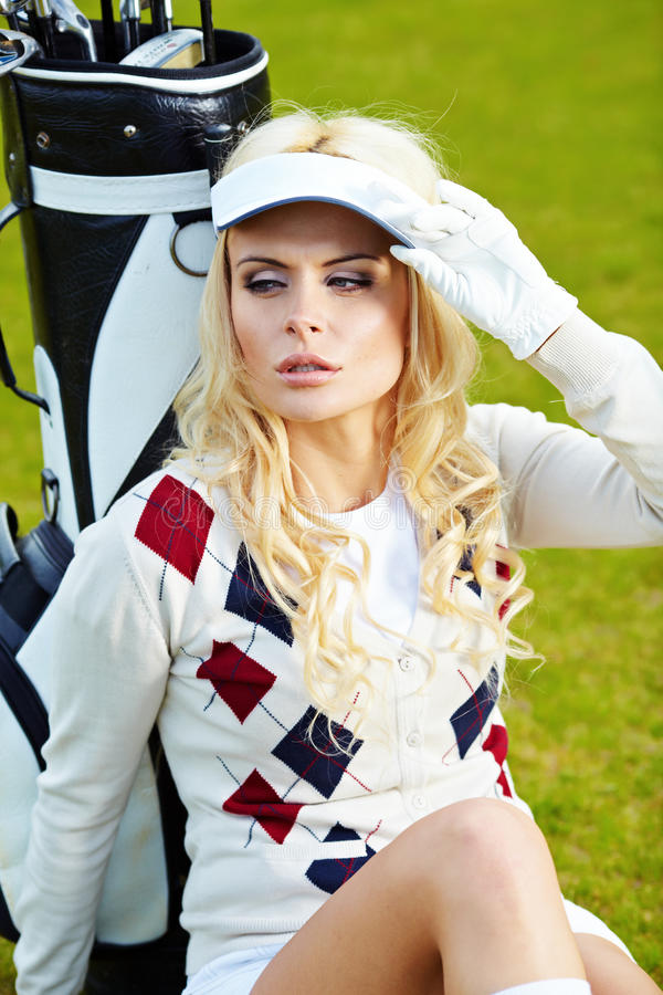 Woman playing golf royalty free stock photography