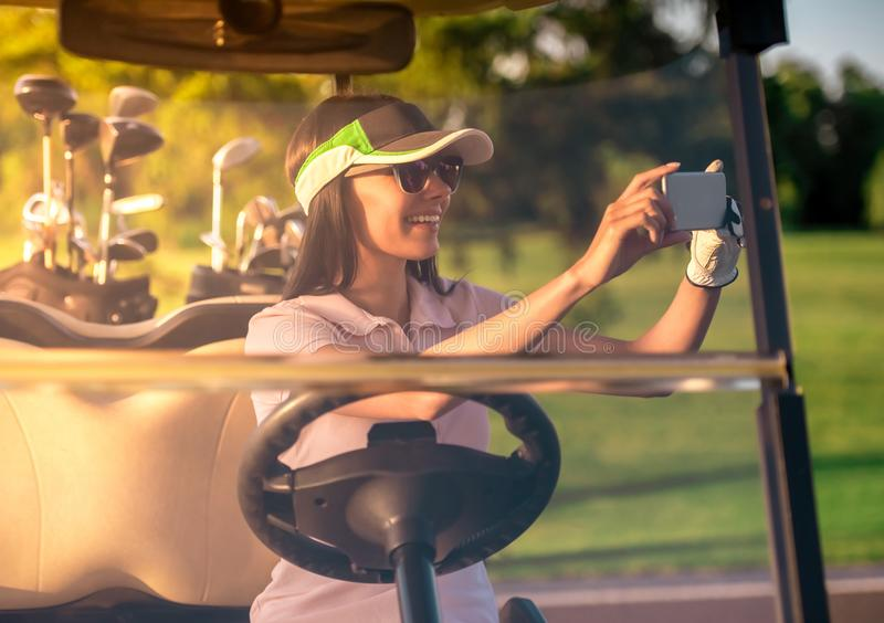 Woman playing golf stock photography