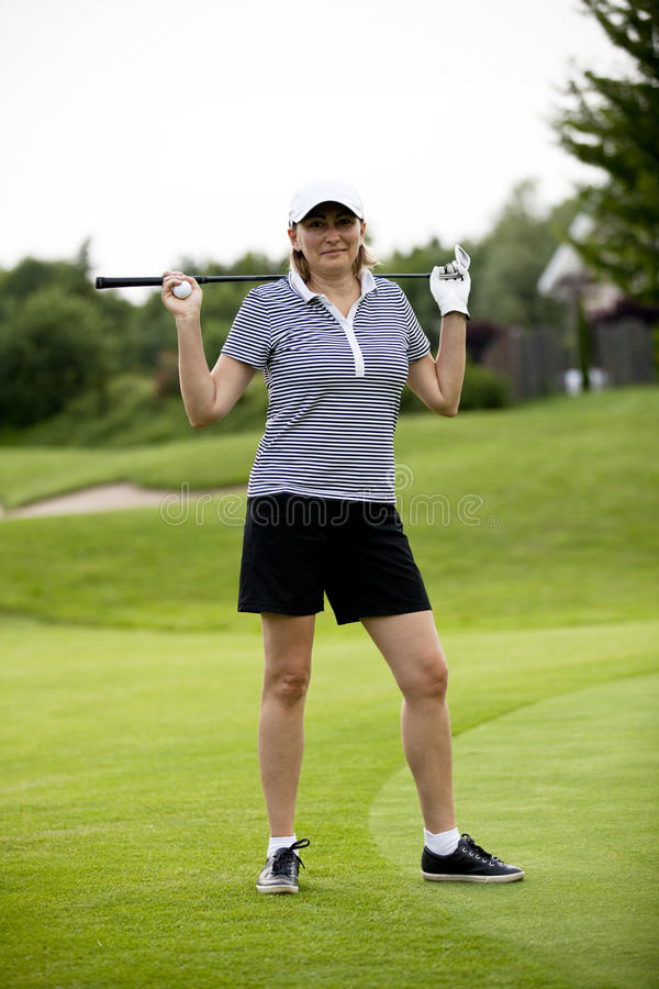 Woman Is Playing Golf On Course  Summer Royalty Free Stock Photography