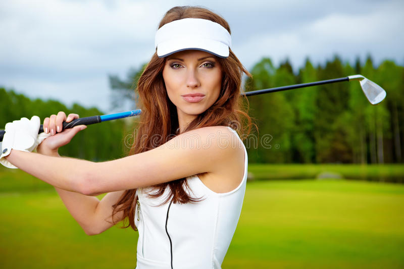 woman playing golf on a green