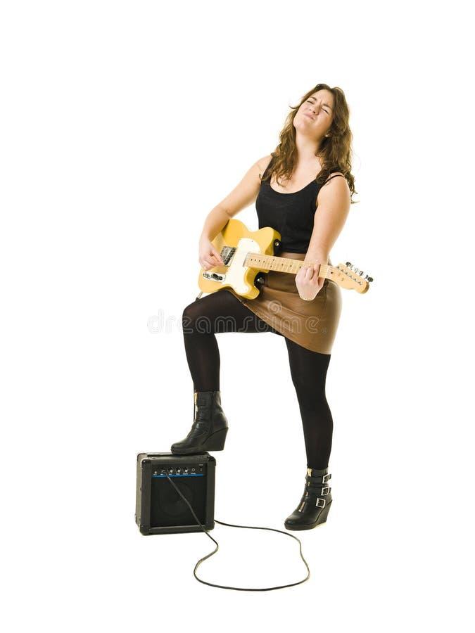 Woman playing guitar stock photos