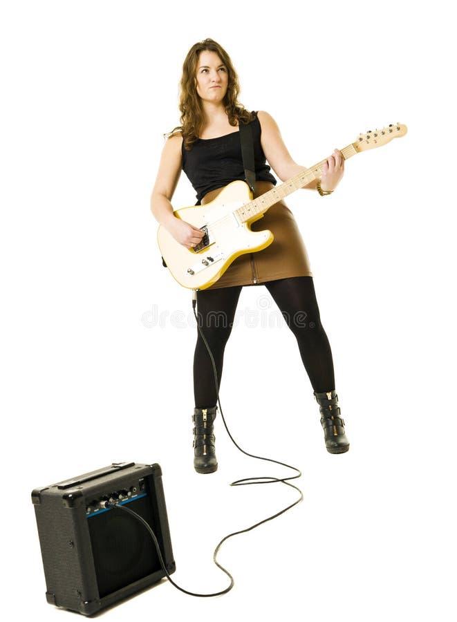 Woman playing guitar stock photo