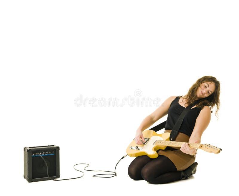 Woman playing guitar royalty free stock image