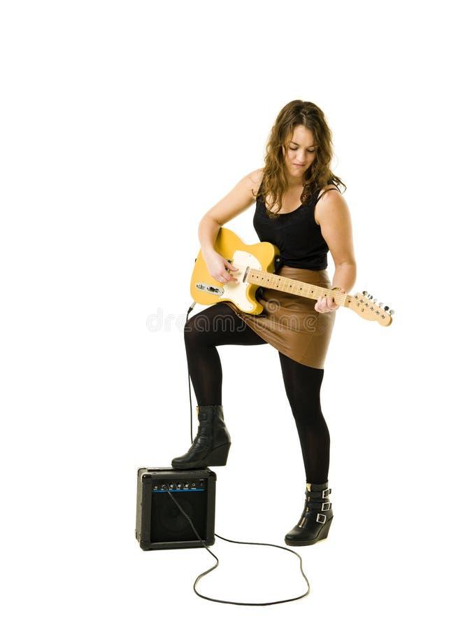 Woman playing guitar stock photography