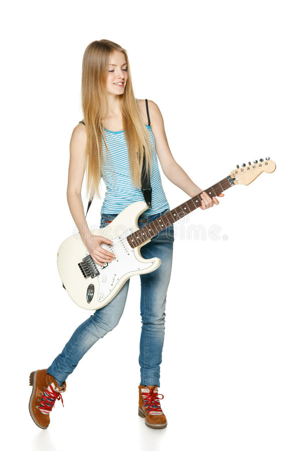 Woman playing the guitar in full length stock photos