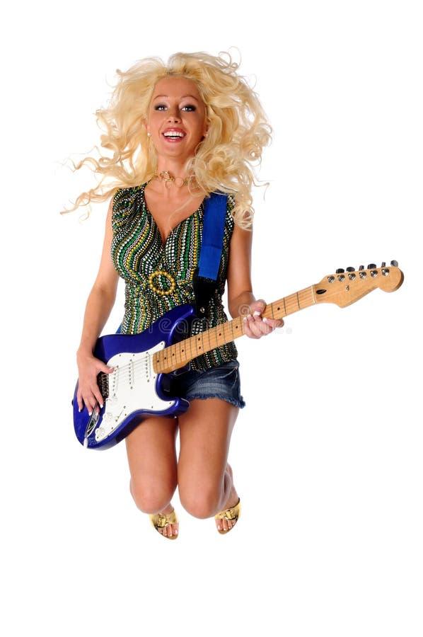 Download Woman Playing Guitar Jumping Stock Photo - Image: 20046288