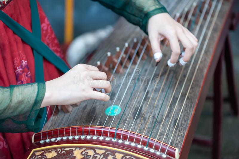 Woman playing Guzheng traditional chinese music instrument royalty free stock photos
