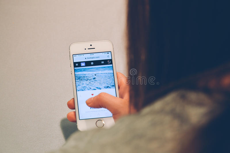 Woman Playing on Iphone stock photography