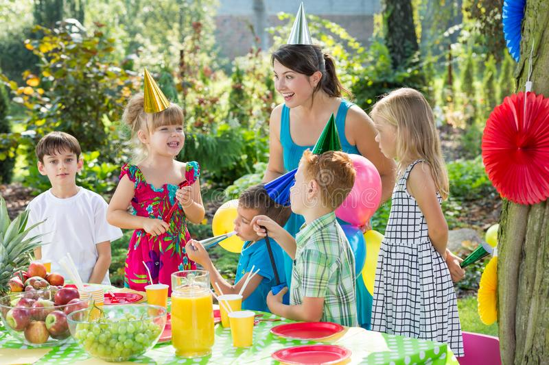 Woman playing with kids royalty free stock photos