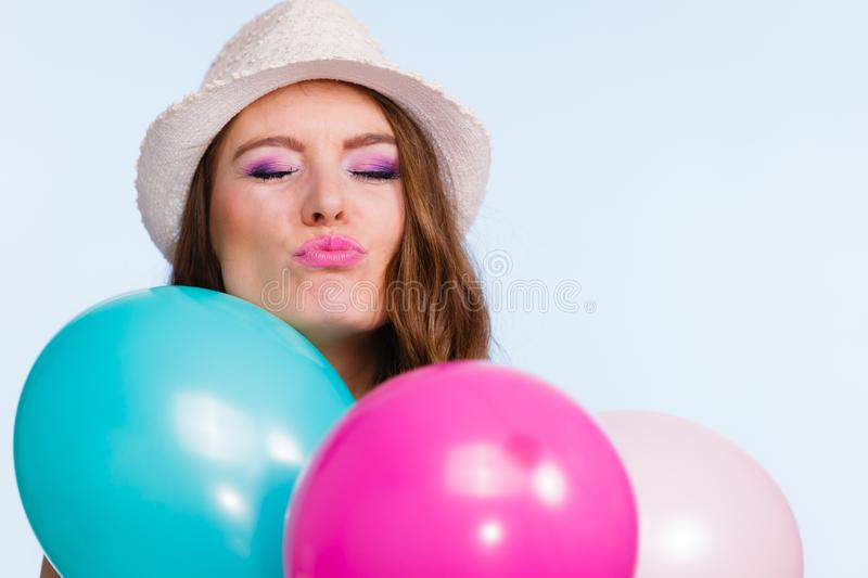 Woman playing with many colorful balloons stock image