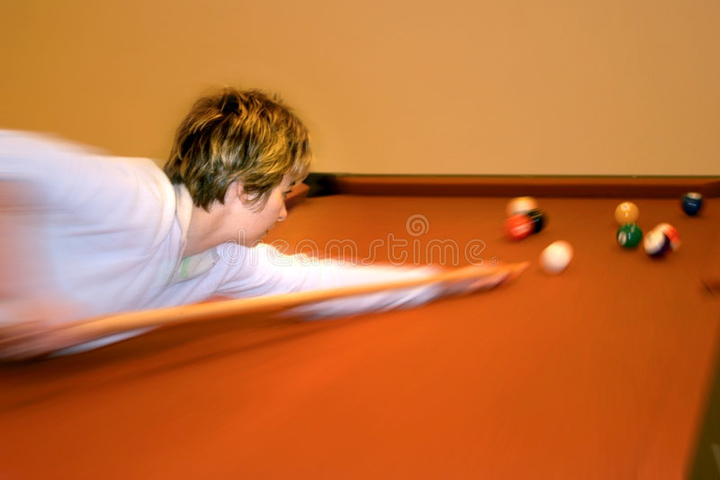 Woman playing pool royalty free stock images
