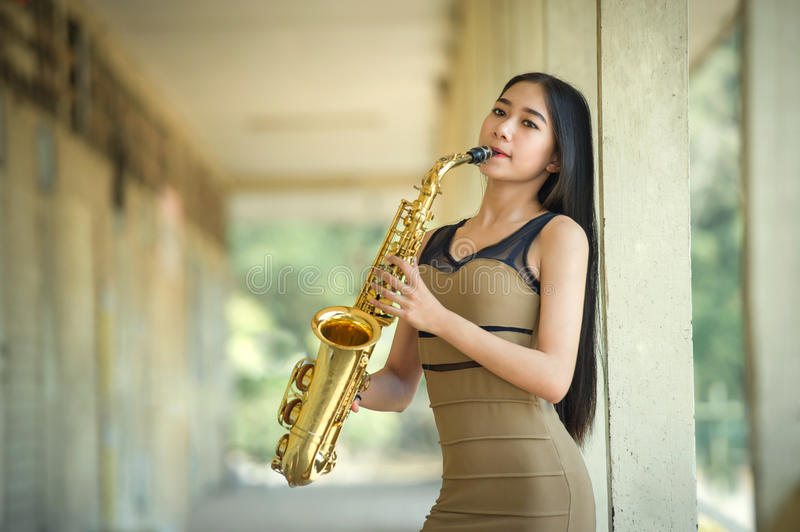 Woman playing saxophone royalty free stock image