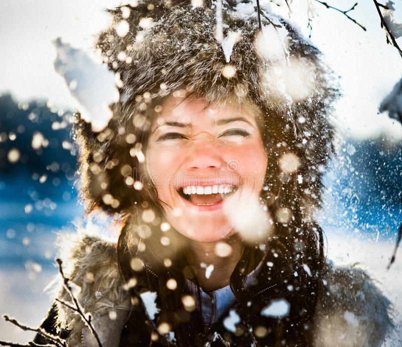 Woman playing in snow stock photography