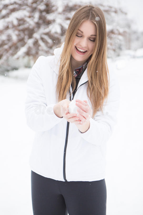 Download Woman Playing In The Snow Making Snow Balls. Stock Photo - Image: 83719881