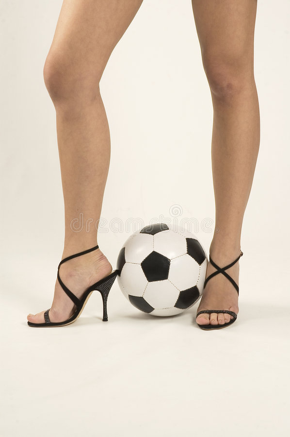 WOMAN PLAYING SOCCER stock photo