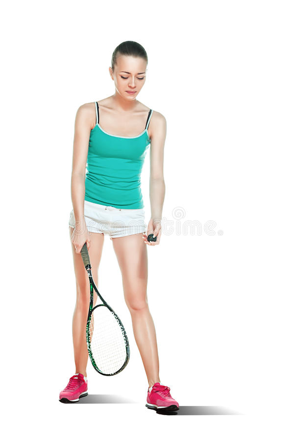 Woman playing squash royalty free stock photography