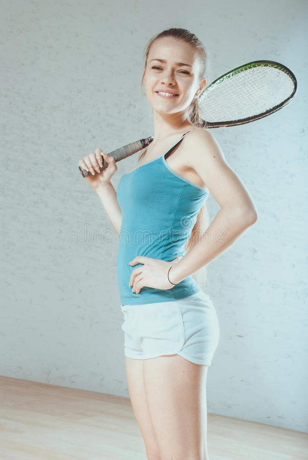Woman playing squash royalty free stock images