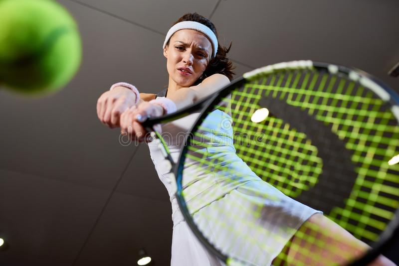 Woman Playing Tennis Low Angle royalty free stock photography