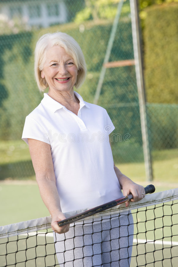 Download Woman Playing Tennis And Smiling Stock Photo - Image: 5560794