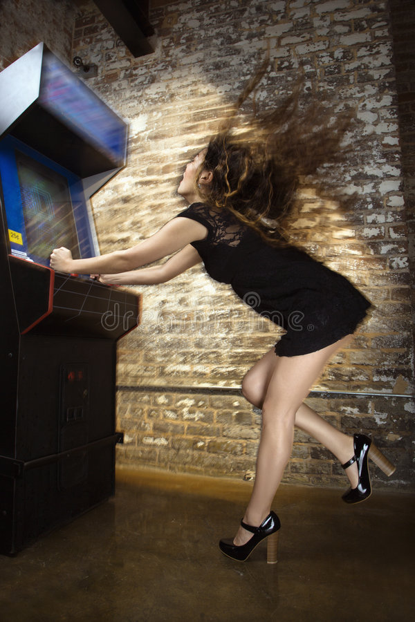 Woman playing video game stock image