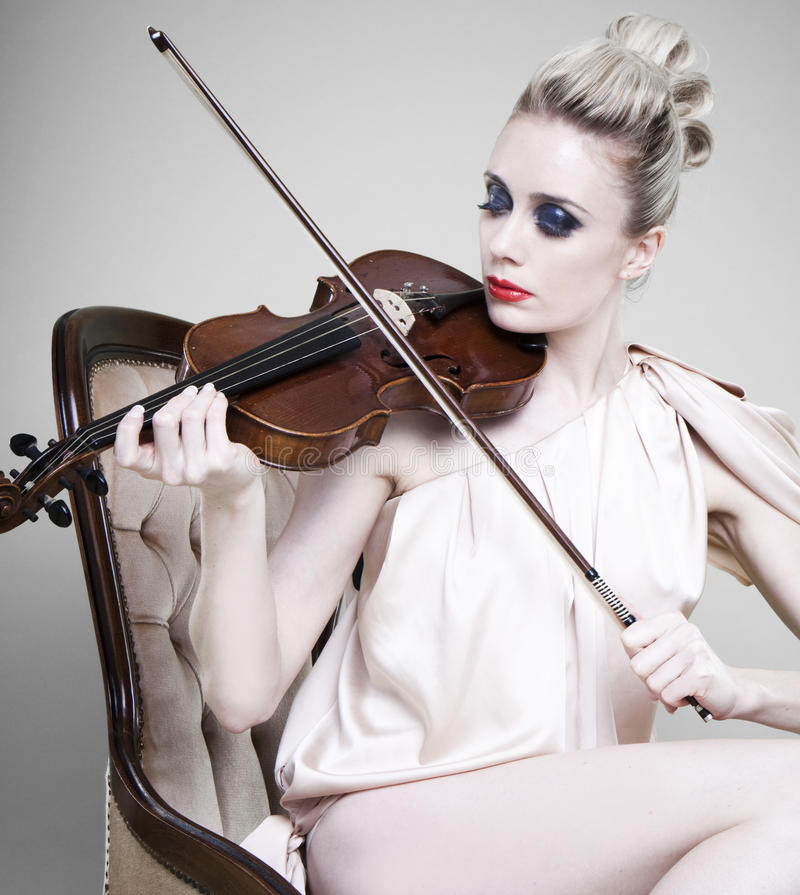 Woman playing violin stock images