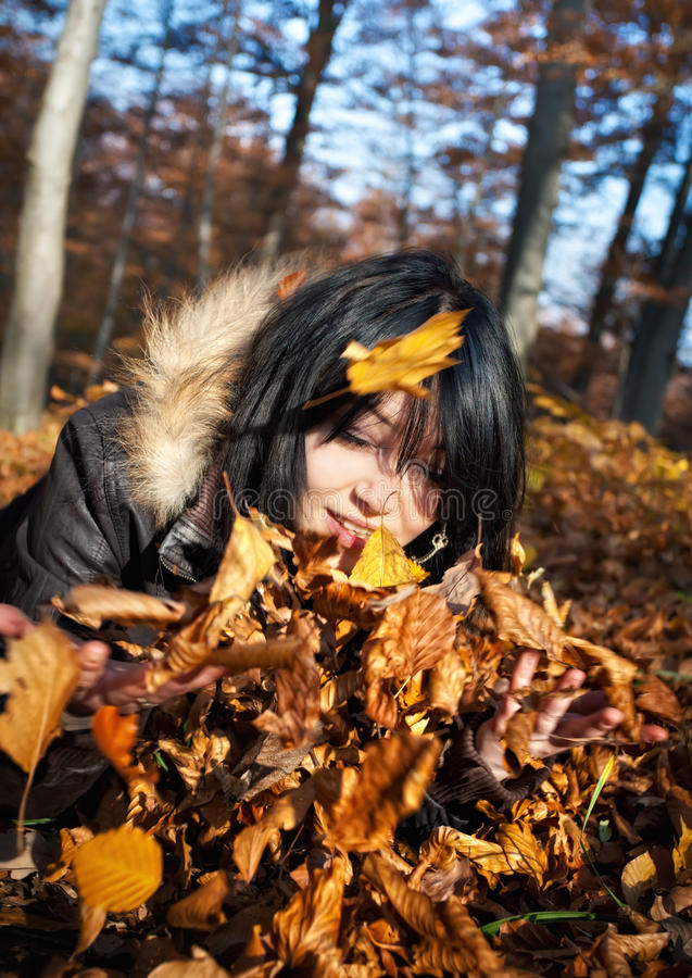 Free Woman Playing With Autumn Leaves Stock Images - 22050004