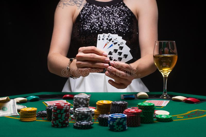 A woman plays in a casino. shows a winning combination on cards. Winning poker.  royalty free stock image