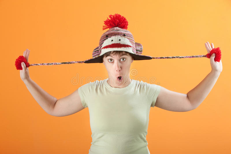 Download Woman Plays with Hat stock image. Image of hold, emotion - 18505605