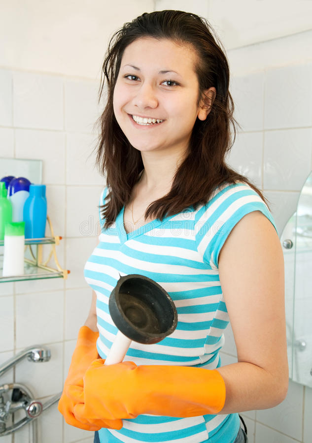Woman with plunger stock photography