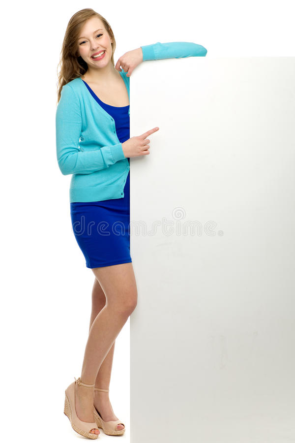 Download Woman Pointing At Blank Poster Stock Photo - Image: 24480628