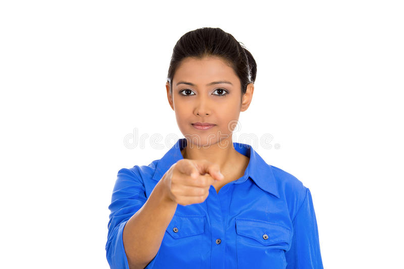 Woman pointing. Closeup portrait of serious young pretty woman, student, worker pointing at you with index finger, isolated on white background. Negative human royalty free stock photos