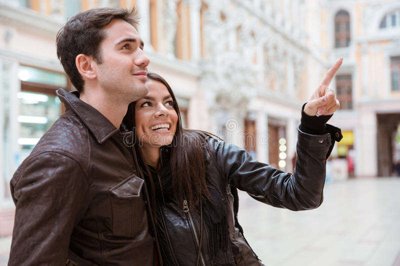 Woman pointing finger on something to her boyfriend stock photos