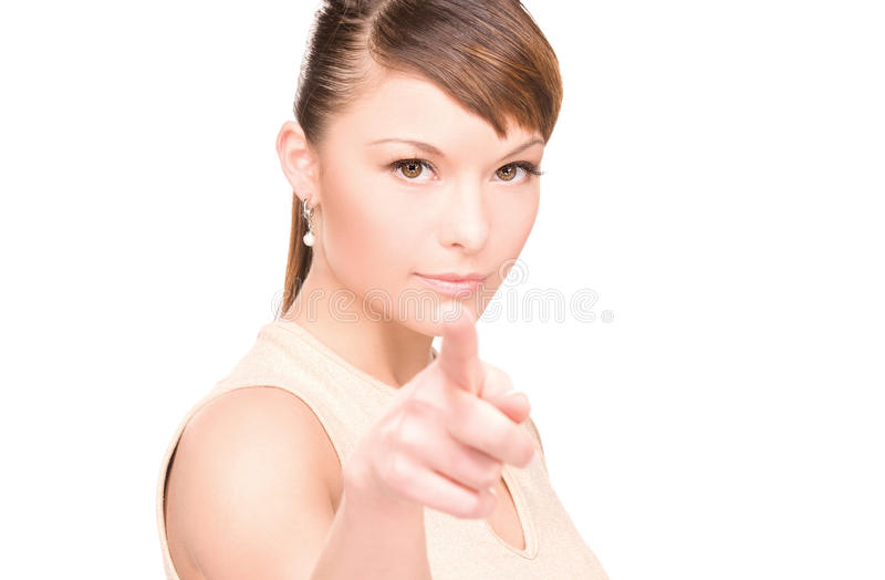 Woman pointing her finger. Picture of attractive young woman pointing her finger royalty free stock photos