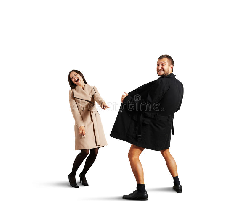 Woman pointing at man in open coat. Laughing women pointing at men in open coat. isolated on white background stock photography