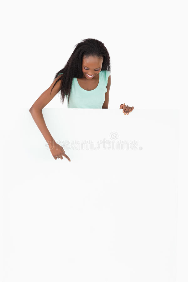 Download Woman Pointing At Placeholder Stock Image - Image: 21860673