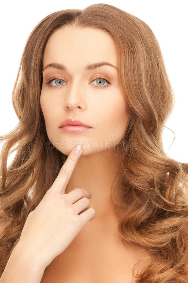 Woman Pointing To Chin Stock Photo