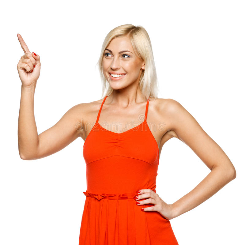 Woman pointing to copy space stock image