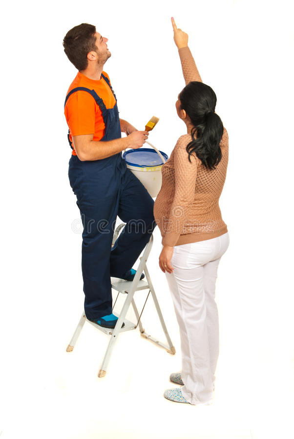 Woman  Pointing To  Painter On Wall Royalty Free Stock Images