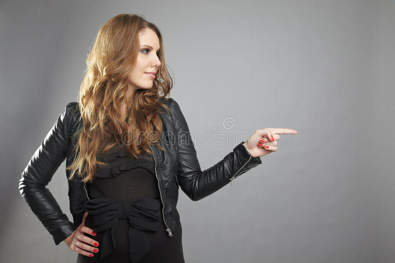 Woman Pointing To The Right Stock Images
