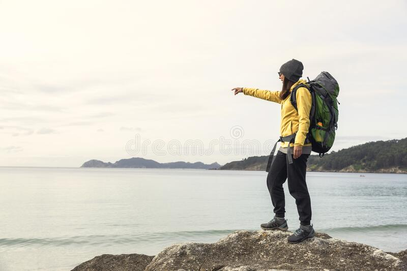 Woman pointing to the view stock photos