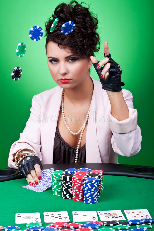 Woman with poker face making a bet. By throwing chips in the air stock images