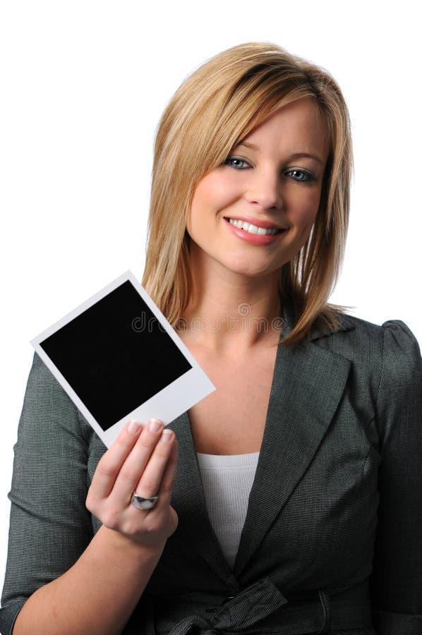 Woman with Polaroid stock photo