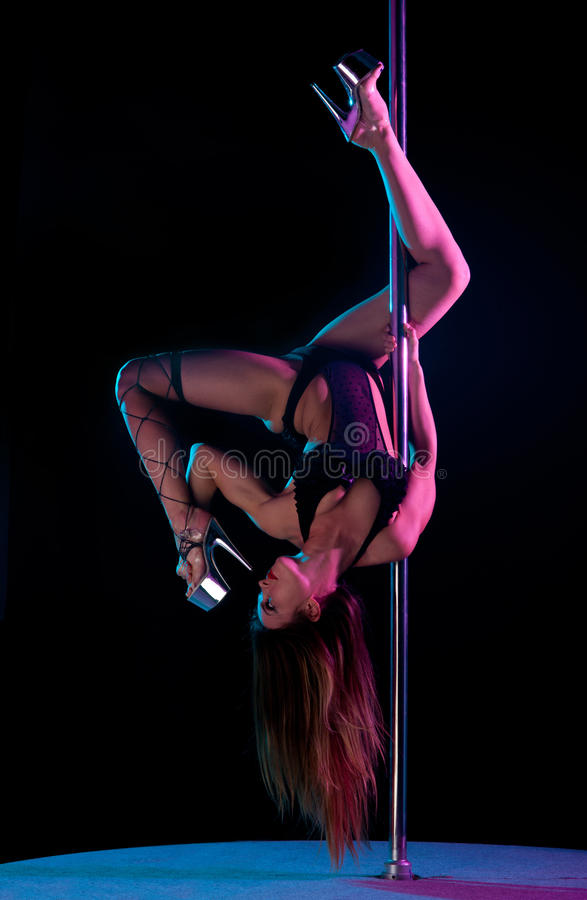 Woman pole dancer stock photography